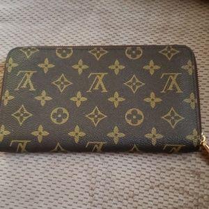 Louis Vuitton Zippered Wallet